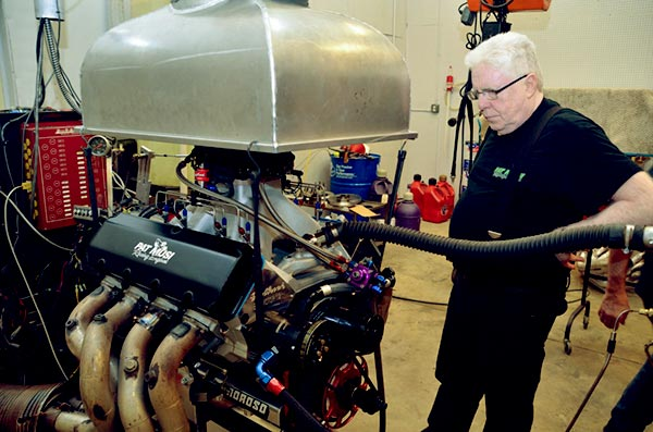Image of Caption: Lizzy's father, Pat is with his 632 Crate Engine