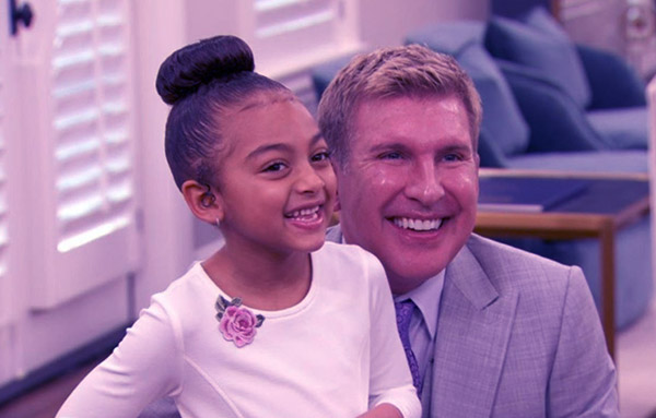 Image of Caption: Kyle Chrisley with his daughter Chloe
