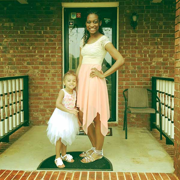 Image of Caption: Angela Victoria Johnson with her daughter Chloe