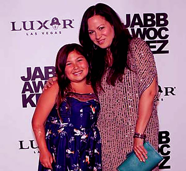 Image of Caption: Anthony Ian's wife and daughter at the grand opening of the Jabbawockeez dance crew's show 'PRiSM' at the Luxor Resort & Casino on May 31, 2013, in Las Vegas, Nevada