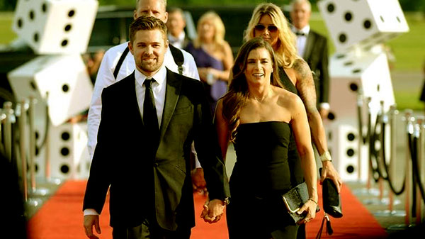 "Image of Caption: Ricky Stenhouse Jr. and Danica Patrick walked on the red carpet at the ""Catwalk for a Cause"" charity event at the Statesville Municipal Airport this past May"