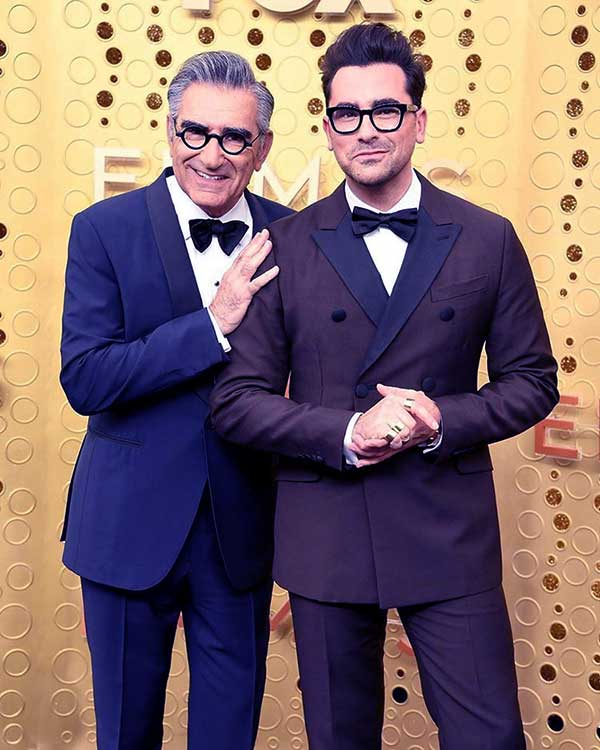 Image of Caption: Eugene and Dan Levy both are playing in the TV series, Schitt's Creek since 2015