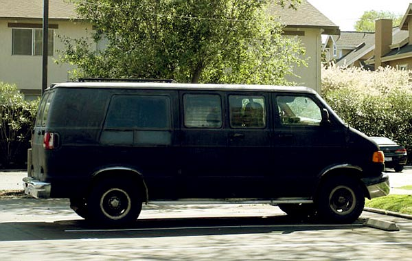 Image of Caption: Alex Aniston black van which he lives and moves around in