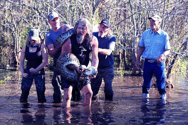 Image of Caption: Dusty Crum and his team on Guardians of the Glades