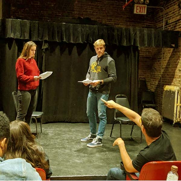 Image of Caption: Luke and Hannah were rehearsing in the acting class