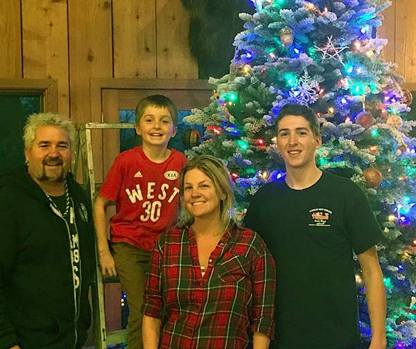 Image of Caption: Ryder Fieri with his father Guy Fieri, mother Lori Fieri and brother Hunter Fieri