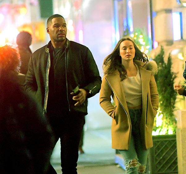 Image of CAption: Kayla, 31, and Michael, 48, were walking outside the restuarant in 2018