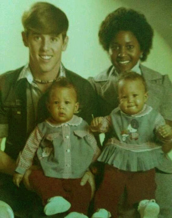 Image of Caption: Darlene and Timothy with their twin daughters; Tamera and Tia
