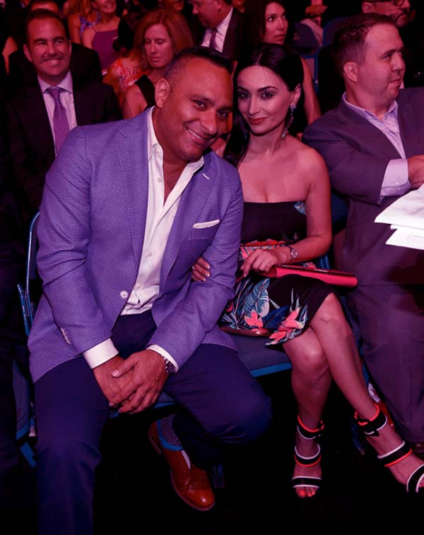 Image of Caption: Russell Peters attends the 2015 NHL Awards with his then-girlfriend, Ruzanna Khetchian