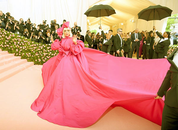 Image of Caption: Lady Gaga stepped wearing a billowing, hot pink gown