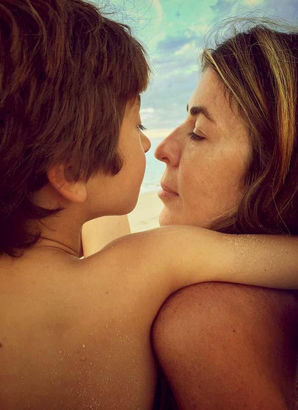 Image of Caption: Nina and her oldest son, Lucas Alexander enjoying the beach