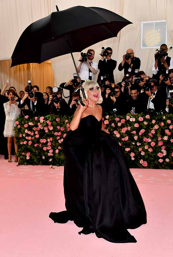 Image of Caption: Gaga in a black gown with a matching umbrella