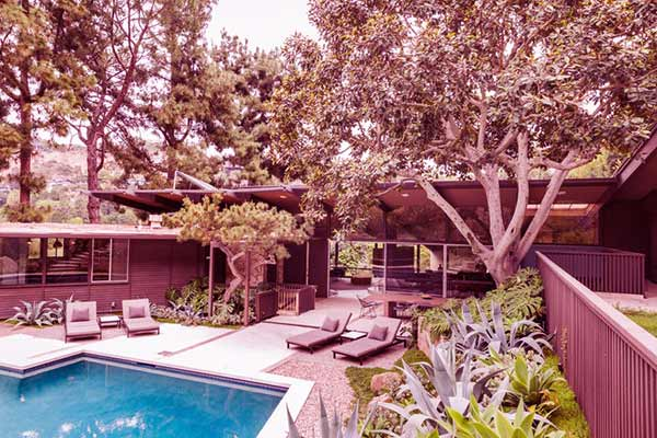 Image of Caption: Nicky's Beverly Hills home has a pool in the backyard