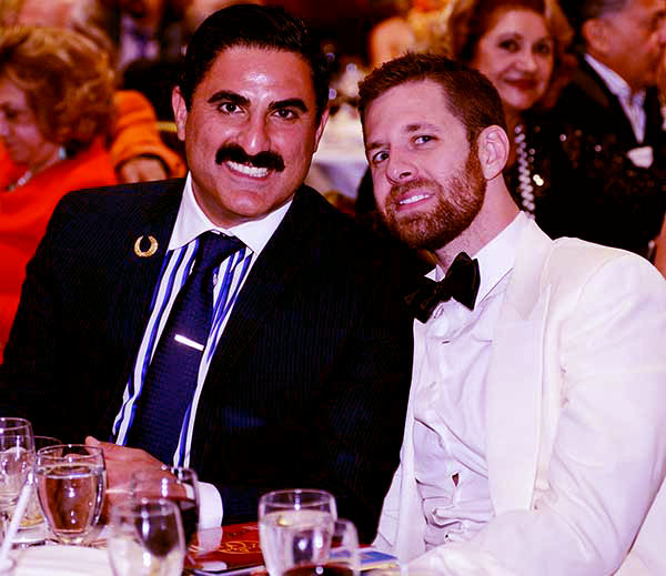 Image of Caption: Reza with his husband, Adam Neely