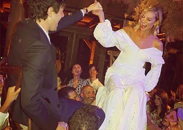 Image of Caption: Designer Jonathan Smikhai designed Karlie's an off-the-shoulder white dress