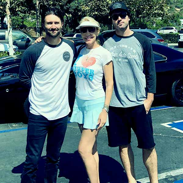 Image of Caption: Linda Thompson with her two sons; Brandon and Brody went out after playing tennis