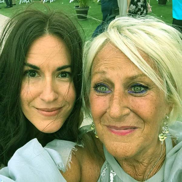 Image of Brooke snap a picture with her mother
