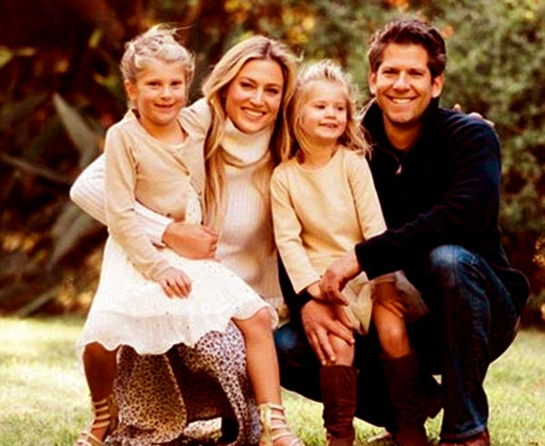 Image of Caption: Cassandra and her husband Michael with two daughters Isabella and Francesca