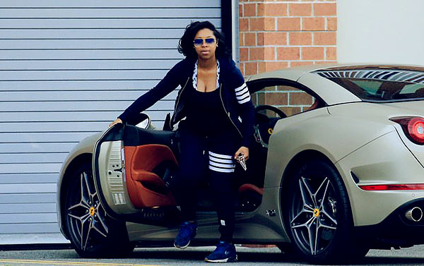 Image of Sharina Hudson spotted with a flashy vehicle in a $1,260 Thom Browne tracksuit