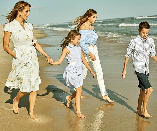 Image of Bella is walking with her siblings and mom on the beach