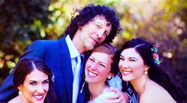 Image of Debra with her two sisters and father