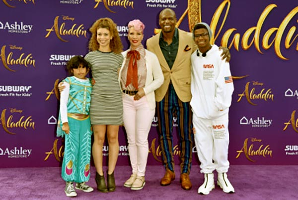 Image of Noami Burton-Crews with her daughter, Miley Crews (Right) and parents, Rebecca Crews and Terry Crews and Isaiah Crews (Left)
