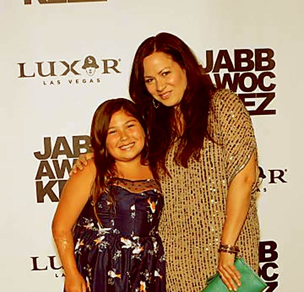 Image of Wren Keasler and her mother at the grand opening of the Jabbawockeez dance crew's show 'PRiSM' at the Luxor Resort & Casino on May 31, 2013, in Las Vegas, Nevada