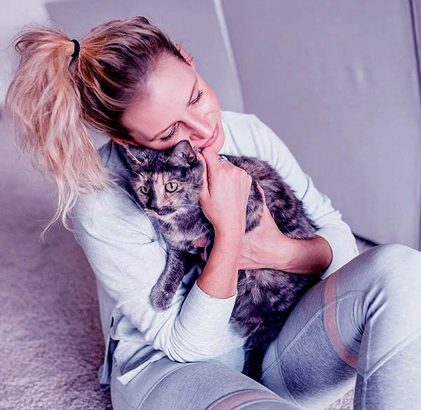 Image of Emily and Zack are also parents of their cat, Wilsy