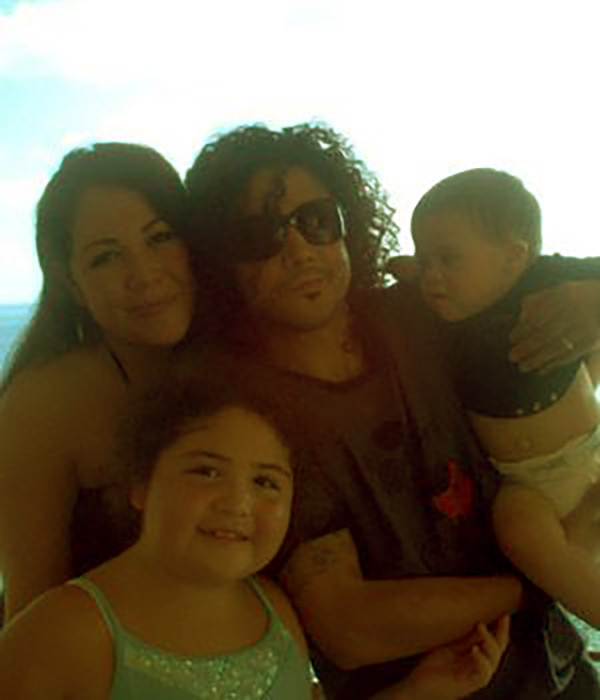 Image of Vanessa with her husband and two children