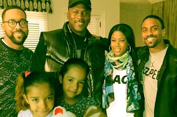Image of Michael Jordan with his five kids
