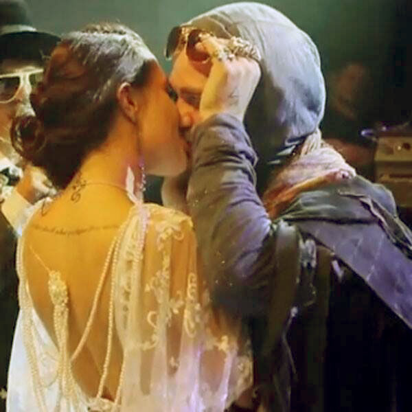Image of Nicole Boyd and Bam Margera were kissing onstage at the event during the Random Hero Festival