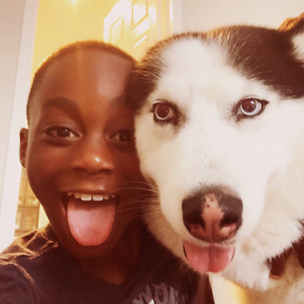 Image of Braylon took a selfie with his dog, Blue