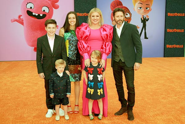 Image of Brandon and Kelly made their appearance in the red carpet with all four kids