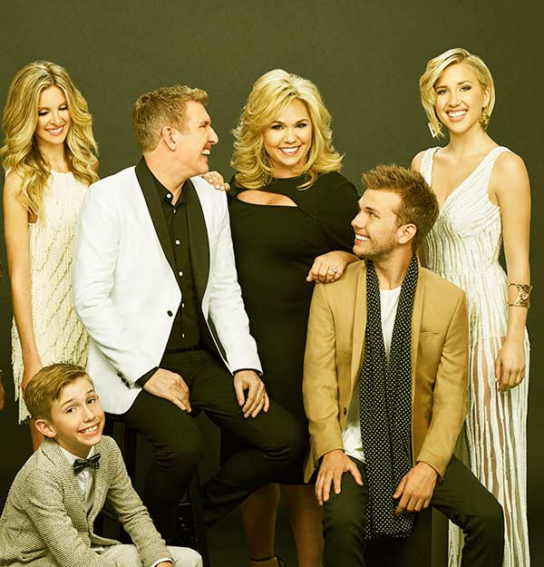 Image of Julie Chrisley and her husband Todd with kids